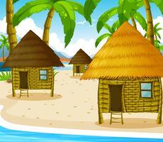 Drie houten huisjes op het strand
