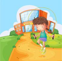 Een meisje speelt in de buurt van de school