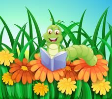 Een worm die een boek leest in de tuin