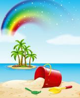 Uitzicht op de oceaan met speelgoed op het zand