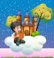 Een jongen die een boek leest voor het drijvende kasteel