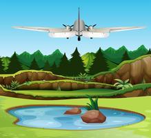 Airplan vliegt over het bos