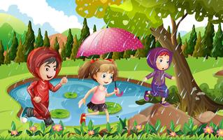Drie kinderen die in de regen lopen