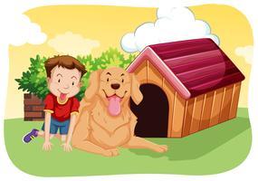 Jongen en hond op het gras