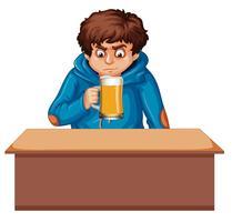 Een tienerjongen die bier drinkt