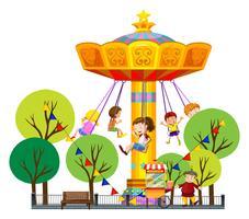 Kinderen rijden op gigantische schommel in het park vector