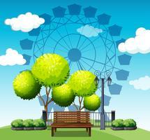 Openbaar park met reuzenrad op achtergrond