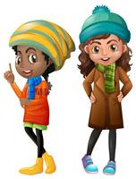 Twee meisjes in de winterkleren vector