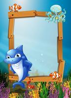 Frame ontwerp met vis onder water vector