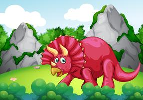 Rode dinosaurus in het park