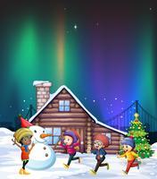 Vier kinderen spelen met sneeuw 's nachts
