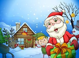 een huis, een kerstman en een rendier