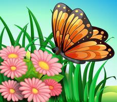 Een grote oranje vlinder in de tuin vector