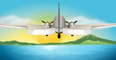 Vliegtuig dat boven de oceaan vliegt