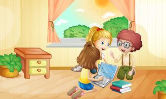 Drie kinderen werken op de computer in de kamer