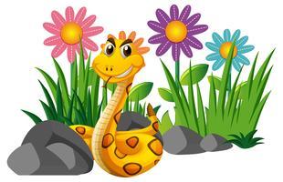 Rammelaar slang in bloementuin