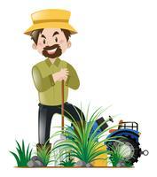 Tuinman die in tuin werkt