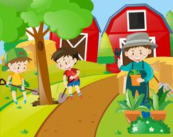 Jongens en tuinman die bomen planten