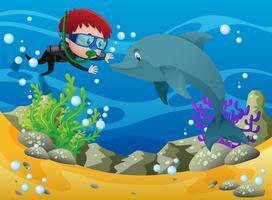 Jongen duiken met dolfijn onderwater vector