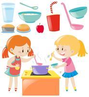 Set van meisjes koken en eten