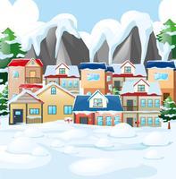 Buurtscène met huizen die door sneeuw worden behandeld