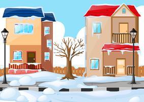 Twee huizen die door de sneeuw worden behandeld vector