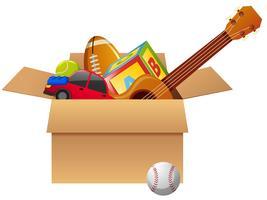 Kartonnen doos vol met speelgoed vector