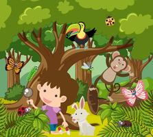 Jongen die wilde dieren in bos bekijkt vector