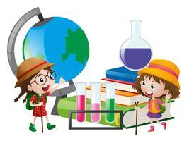 Schoolmeisjes met globe en boeken