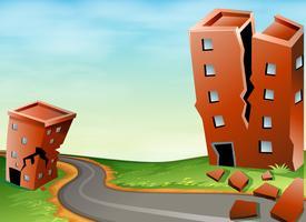 Scène van aardbeving met gebarsten gebouwen