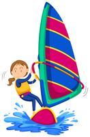 Vrouw die in de oceaan windsurfing