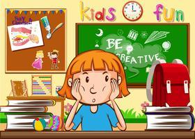 Meisje dat in het klaslokaal leert vector