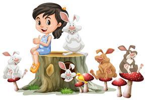 Meisje en schattige konijnen op log