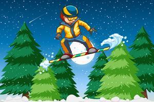 Een jonge man snowboarden