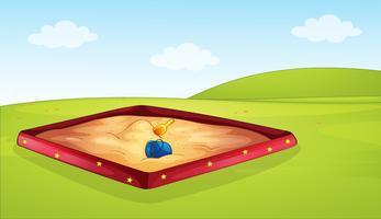 Een zandbak in de speeltuin