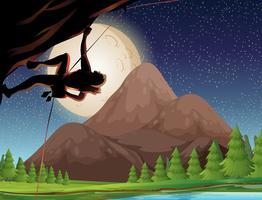 Rotsklimmen op volle maan nacht
