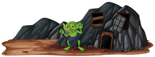 Een enge kobold naast grot