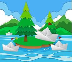 Papierboten die op het meer drijven