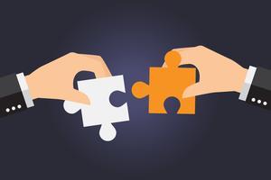 Bedrijfsmensen die overmaatse puzzel samen oplossen