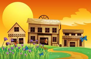 Een zicht op de zonsondergang en de drie huizen