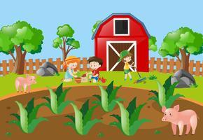 Kinderen die boom in het boerenerf planten