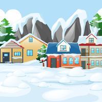 Huizen in dorp bedekt met sneeuw