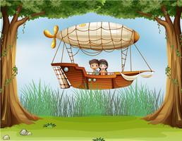 Kinderen rijden in een luchtschip vector