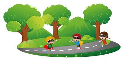 Parkscène met kinderen in heldenuitrusting het spelen vector