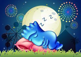 Een monster dat boven het kussen in het pretpark slaapt vector