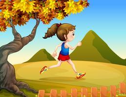 Een vrouw die in de heuvels jogt