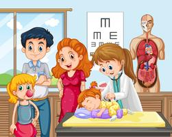 Een dokter die een baby controleert