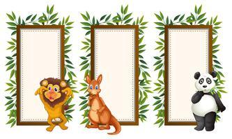 Bannermalplaatje met drie wilde dieren vector