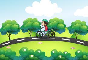 Een jongen in zijn fiets op straat