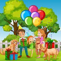Familie die verjaardagspartij in het park hebben vector